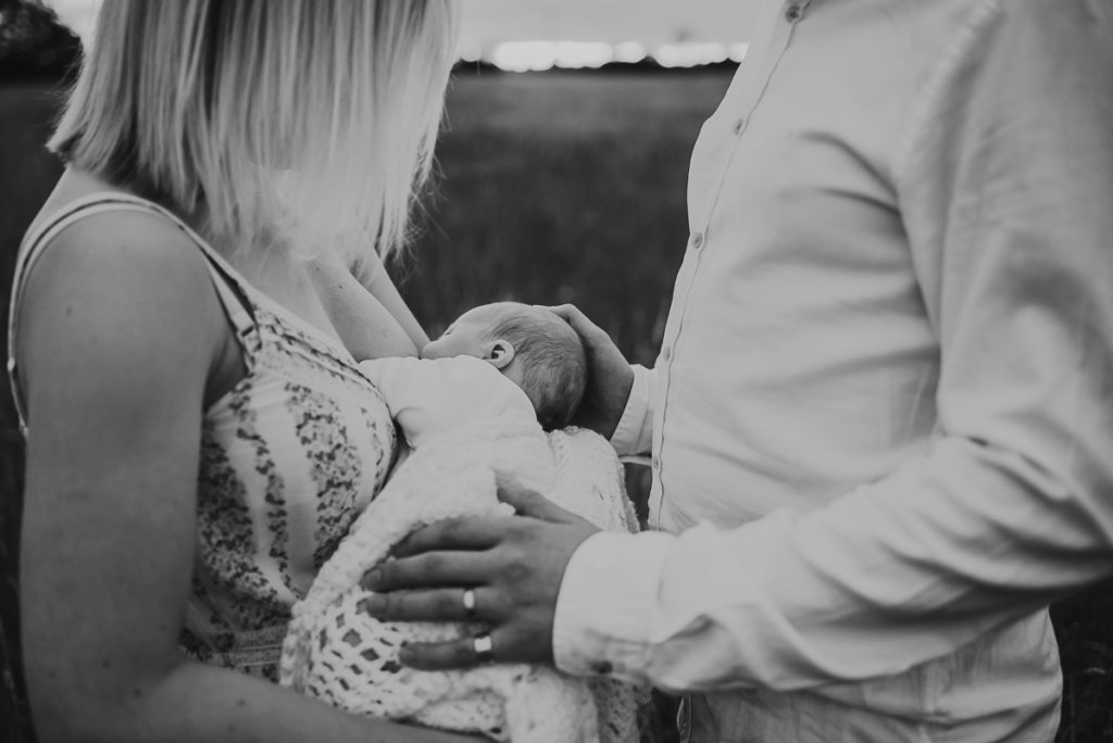 outdoor newborn photography during sunset